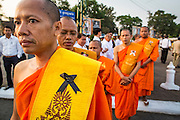 "01 FEBRUARY 2013 - PHNOM PENH, CAMBODIA:  Buddhist monks walk to their place in line before the funeral procession of former Cambodian King Norodom Sihanouk left the Royal Palace in Phnom Penh. Norodom Sihanouk (31 October 1922 - 15 October 2012) was the King of Cambodia from 1941 to 1955 and again from 1993 to 2004. He was the effective ruler of Cambodia from 1953 to 1970. After his second abdication in 2004, he was given the honorific of ""The King-Father of Cambodia."" Sihanouk died in Beijing, China, where he was receiving medical care, on Oct. 15, 2012. His cremation is will be on Feb. 4, 2013. Over a million people are expected to attend the service.   PHOTO BY JACK KURTZ"