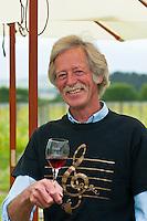 Tim Coney tests one of his Pinot Noirs, Coney Wines, Martinborough, Wairarapa region near Wellington, North Island, New Zealand
