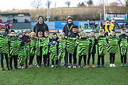 FGR U'8's receive their shirts from Forest Green Rovers Liam Shephard(2) during the EFL Sky Bet League 2 match between Forest Green Rovers and Salford City at the New Lawn, Forest Green, United Kingdom on 18 January 2020.