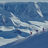 ANTARCTICA. Extreme skiers descend Mount Berry above Calley Glacier on Antarctic Peninsula.  Detroit Plateau background.