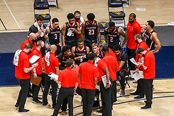 Jan 25, 2021; Morgantown, West Virginia, USA; Texas Tech Red Raiders players listen to Texas Tech Red Raiders head coach Chris Beard during a timeout during the second half against the West Virginia Mountaineers at WVU Coliseum. Mandatory Credit: Ben Queen-USA TODAY Sports