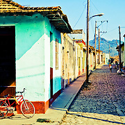 A typical street scene in the historical town of Trinidad, Cuba.<br /> <br /> + ART PRINTS +<br /> To order prints or cards of this image, visit:<br /> http://greg-stechishin.artistwebsites.com/featured/trinidad-greg-stechishin.html