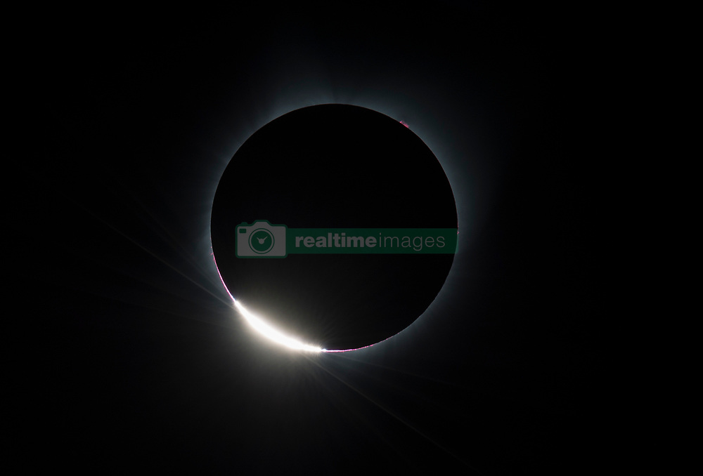 The Diamond Ring  effect is seen as the moon makes its final move over the sun during the total solar eclipse on Monday, August 21, 2017 above Madras, Oregon. A total solar eclipse swept across a narrow portion of the contiguous United States from Lincoln Beach, Oregon to Charleston, South Carolina. A partial solar eclipse was visible across the entire North American continent along with parts of South America, Africa, and Europe.  Photo Credit: (NASA/Aubrey Gemignani)  Please note: Fees charged by the agency are for the agency's services only, and do not, nor are they intended to, convey to the user any ownership of Copyright or License in the material. The agency does not claim any ownership including but not limited to Copyright or License in the attached material. By publishing this material you expressly agree to indemnify and to hold the agency and its directors, shareholders and employees harmless from any loss, claims, damages, demands, expenses (including legal fees), or any causes of action or allegation against the agency arising out of or connected in any way with publication of the material.
