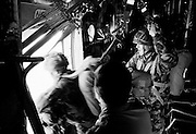 Paratroopers preparing to jump from a Hercules transport plane.Part of a three year photography study.<br /> Photography by Zac Macaulay<br /> Tel +44(0)208 944 6933<br /> www.linkphotographers.com