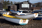 Dinghies on the beach at Orford, Suffolk, England