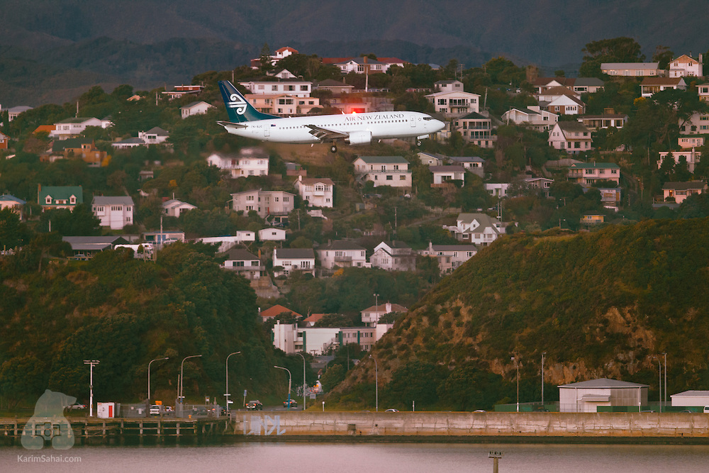 An Air Zealand aircraft flies over Miramar harbour prior to landing at the nearby Wellington International Airport, New Zealand.
