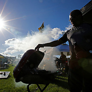 ORLANDO, FL - OCTOBER 14: A UCF fan grills as he tailgates during a NCAA football game between the East Carolina Pirates and the UCF Knights at Spectrum Stadium on October 14, 2017 in Orlando, Florida. (Photo by Alex Menendez/Getty Images)