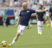 JACKSONVILLE, FL - JUNE 07:  Midfielder Michael Bradley #4 of the United States warms up before the international friendly match against Nigeria at EverBank Field on June 7, 2014 in Jacksonville, Florida.  (Photo by Mike Zarrilli/Getty Images)