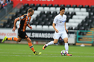 Ki Sung-Yueng of Swansea city (r)  in action.Premier league match, Swansea city v Hull city at the Liberty Stadium in Swansea, South Wales on Saturday 20th August 2016.<br /> pic by Andrew Orchard, Andrew Orchard sports photography.