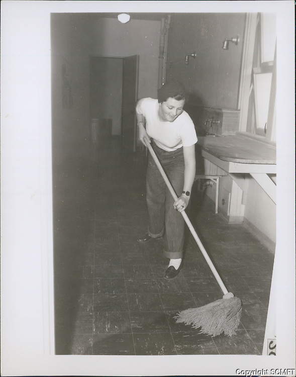 1943 A volunteer mops the floor after an evening at the Hollywood Canteen.