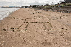 Portobello, Edinburgh's seaside suburb, is awash with Art. Almost everywhere you look there is something to see as the Art Walk Porty community art festival takes place, now extended to run over ten days covering the first two weekends of September. Pictured: Mysterious figure on the beach as an anonymous artist joins in the event.<br /> <br /> <br /> © Jon Davey/ EEm
