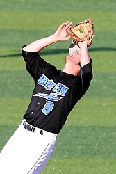 11 July 2012:  Second Baseman Chris Wade (Windy City Thunderbolts) stumbles around under a high pop up and makes a very off-balanced catch during the Frontier League All Star Baseball game at Corn Crib Stadium on the campus of Heartland Community College in Normal Illinois