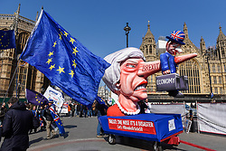 © Licensed to London News Pictures. 01/04/2019. LONDON, UK. An effigy of Theresa May, Prime Minister, is positioned with Pro-Remain supporters protesting outside the Houses of Parliament. MPs are debating eight motions related to Brexit with voting to begin later this evening.  Photo credit: Stephen Chung/LNP