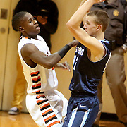 New Hanover's Tyree Johnson guards Hoggard's Shane Willis. (Jason A. Frizzelle)