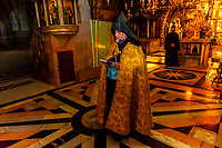An Armenian Orthodox mass, Church of the Holy Sepulchre (site of the last five stations of the Cross and venerated as the place where Jesus was crucified and buried), the Christian Quarter, Old City, Jerusalem, Israel.