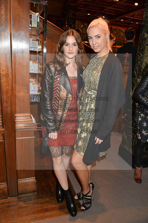 Left to right, SAI BENNETT and AMBER LE BON at the opening of the exhibition 'My Mother Was A Reeler' at Etro, 43 Old Bond Street, London on 5th October 2016.