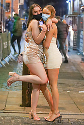 © Licensed to London News Pictures. 5/12/2020 Liverpool, UK.  Revellers wearing face masks pose for a picture as they enjoy the first weekend in Liverpool city centre  after lockdown restrictions were eased. Photo credit: Ioannis Alexopoulos/LNP