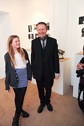 NICK ASHLEY and his daughter EDIE ASHLEY at a private view of photographs by Nick Ashley held at the Sladmore Gallery, 32 Bruton Place, London on 13th January 2010.