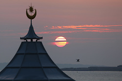 © Licensed to London News Pictures. 03/10/2015. Southsea, Hampshire, UK. The roof of the band stand on Southsea seafront in Hampshire during sunset yesterday evening, Saturday 3rd October 2015. Photo credit : Rob Arnold/LNP