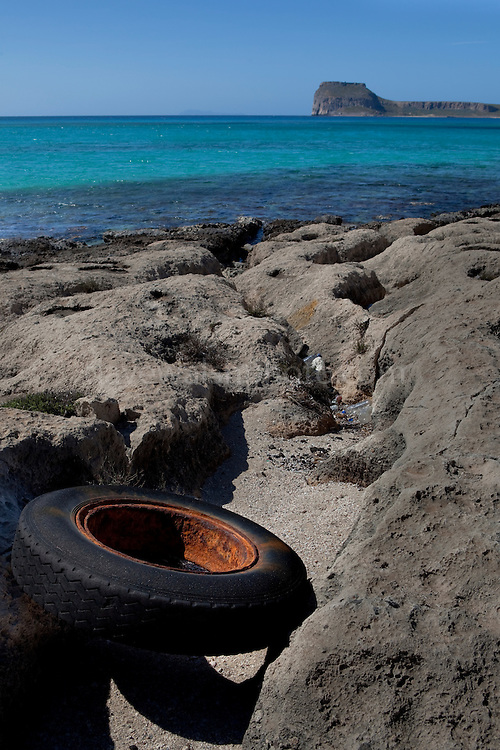 Tyre on Balos Beach, on Gramvousa peninsula, in north western Crete, Greece. The beach is famous for its white sands and turquoise waters and is a protected nature reserve.