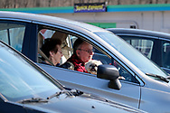 Carolyn Rader, left, of Northampton, and her husband Robert Rader, right, of Nothampton, tune into a radio station that will broadcast a sermon while sitting in their car as Bethany Wesleyan Church holds their Sunday worship service Mar. 22, 2020, at Becky's Drive-In in Walnutport, Pennsylvania. Concerns over the coronavirus have closed churches in an effort to avoid gatherings of large crowds.