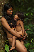 Huaorani Indian women & child - Norma & Romelia Kaiga. Gabaro Community. Yasuni National Park.<br /> Amazon rainforest, ECUADOR.  South America<br /> This Indian tribe were basically uncontacted until 1956 when missionaries from the Summer Institute of Linguistics made contact with them. However there are still some groups from the tribe that remain uncontacted.  They are known as the Tagaeri & Taromanani. Traditionally these Indians were very hostile and killed many people who tried to enter into their territory. Their territory is in the Yasuni National Park which is now also being exploited for oil.