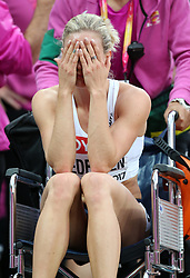 Norway's Isabelle Pedersen receives treatment for an injury in the Women's 100m Hurdles semi-final heat three during day eight of the 2017 IAAF World Championships at the London Stadium.