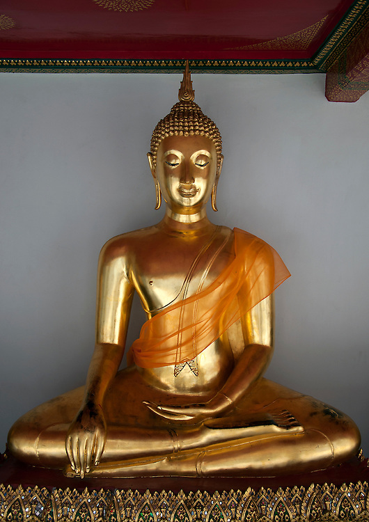 Amazing golden buddha statue located within one of the temples, Bangkok, Thailand.
