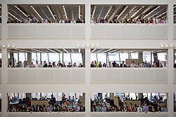 © Licensed to London News Pictures . 14/11/2013 . Manchester , UK . Crowds gather to overlook the foyer as the Queen's arrival is anticipated . Queen Elizabeth II and the Duke of Edinburgh visit the Coop building at 1 Angel Square , Manchester , this morning ( 14th November 2013 ) . Photo credit : Joel Goodman/LNP