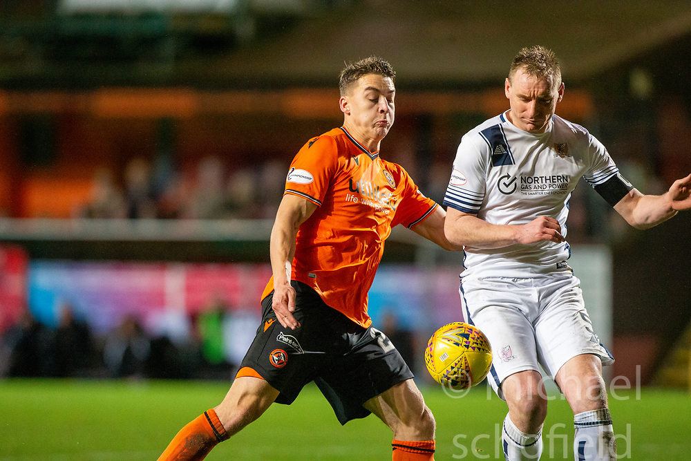 Dundee United's Louis Appere and Alloa Athletic's Andy Graham. Dundee United 2 v 1 Alloa Athletic, Scottish Championship game played 7/12/2019 at Dundee United's stadium Tannadice Park.