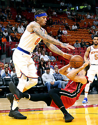 March 21, 2018 - Miami, FL, USA - The Miami Heat's Goran Dragic slips under the basket as he is guarded by the New York Knicks' Michael Beasley in the first quarter at the AmericanAirlines Arena in Miami on Wednesday, March 21, 2018. (Credit Image: © Charles Trainor Jr/TNS via ZUMA Wire)