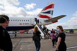 © Licensed to London News Pictures. 16/07/2021. Edinburgh, Passengers wearing face coverings board a British Airways aircraft at Edinburgh Airport. The Scottish government has announced that from 19 July, fully vaccinated UK residents and all children will be able to travel to amber list countries without needing to quarantine when re-entering the country. Photo credit: Dinendra Haria/LNP