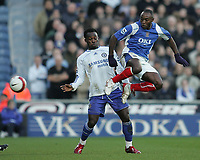 Photo: Lee Earle.<br /> Portsmouth v Chelsea. The Barclays Premiership. 03/03/2007.Chelsea's Michael Essien (L) watches as Portsmouth's Lomana Lua Lua clears.