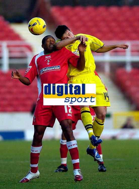 Photo: Alan Crowhurst.<br />Swindon Town v Bury FC. Coca Cola League 2. 25/11/2006. Swindon's Ricky Shakes (L)  and Richard Baker challenge for the ball.