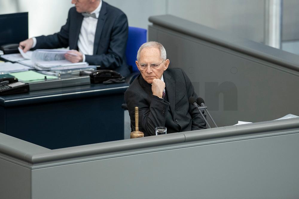 """25 MAR 2020, BERLIN/GERMANY:<br /> Wolfgang Schaeuble, CDU, Praesident des Deutschen Bundestages, allein, ohne die üblichen Schriftfuehrer an seiner Seite, Bundestagsdebatte zu """"COVID 19 - Kreditobergrenzen, Nachtragshaushalt, Wirtschaftsfonds"""", Plenum, Reichstagsgebaeude, Deutscher Bundestag<br /> IMAGE: 20200325-01-009<br /> KEYWORDS: Pandemie, Corona, Sitzung, Debatte, Wolfgang Schäuble"""