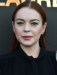 File photo - Lindsay Lohan attends the Saint Laurent show as part of the Paris Fashion Week Womenswear Spring/Summer 2019 at Trocadero on September 25, 2018 in Paris, France. A rumor says that Lohan and the crown prince of Saudi Arabia Mohamed Bin Salman, or MBS, have gotten close, and that he's been flying her around in his jets and showering her with presents, including a gift-wrapped credit card. Photo by Laurent Zabulon/ABACAPRESS.COM