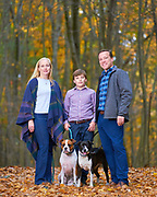 Family portrait session at Bower Springs Trail in Bolton. Mom, dad, son and two dogs surrounded by fall leaves and trees