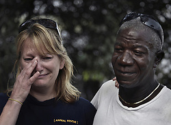 March 6, 2016 - Charlesville, Liberia - ''Those chimps are living things. They are us,'' says JOSEPH THOMAS.  .KATHLEEN CONLEE with HSUS weeps with JOSEPH THOMAS, with LCR (Liberian Chimpanzee Rescue), a program of Humane Society of the United States, as they hold back tears on an island designated as new sanctuary to be built for the chimps.  He was formerly employed by New York Blood Center which stopped all funding for food and water when they retired the chimps formerly used for experimentation. HSUS and NYBC came to an agreement recently in May 2017 after years of discussion about the care of research chimps NYBC had abandoned.  In March 2016, a team from HSUS visits to view the situation.  NYBC also refused to pay their original caregivers who had worked for the center and were abandoned as well.  They initially used their own meager finances to continue feeding them.  Over 60 chimps now live on six islands serving as a sanctuary run by Jenny and James Desmond to improve the dire situation in which the chimpanzees were left to die. (Credit Image: © Carol Guzy via ZUMA Wire)