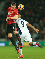 17 December 2016 - Premier League - West Bromwich Albion v Manchester United - Phil Jones of Manchester United wins a header from Solomon Rondon of West Bromwich Albion - Photo: Paul Roberts / Offside.