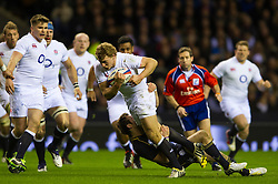 England Inside Centre (#12) Billy Twelvetrees (Gloucester) is tackled on the break during the second half of the match - Photo mandatory by-line: Rogan Thomson/JMP - Tel: Mobile: 07966 386802 02/02/2013 - SPORT - RUGBY UNION - Twickenham Stadium - London. England v Scotland - 2013 RBS Six Nations Championship. The winner of this fixture is awarded the Calcutta Cup.