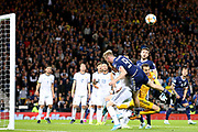 Guilherme Marinato of Russia (1) (Locomotiv Moscow) clears the danger from Scotland forward Oliver McBurnie (9) (Sheffield United) during the UEFA European 2020 Qualifier match between Scotland and Russia at Hampden Park, Glasgow, United Kingdom on 6 September 2019.
