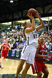 18 March 2011: Stacey Arlis gets the move and basket defended by Bethany Morrison during an NCAA Womens basketball game between the Washington University Bears and the Illinois Wesleyan Titans at Shirk Center in Bloomington Illinois.