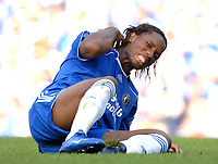 Photo: Ed Godden.<br />Chelsea v Charlton Athletic. The Barclays Premiership. 09/09/2006. Chelsea's Didier Drogba lies on the ground after a bad challenge.