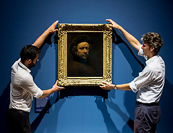 Senior Curator of Northern European Art with the 1national 1galleries of Scotland, Dr Tico Seifert (right)  puts the finishing touches to one of the priceless paintings by Rembrandt, assisted by gallery staff.<br /> <br /> © Dave Johnston / EEm