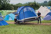 Moving hose Glastonbury style - The 2016 Glastonbury Festival, Worthy Farm, Glastonbury.