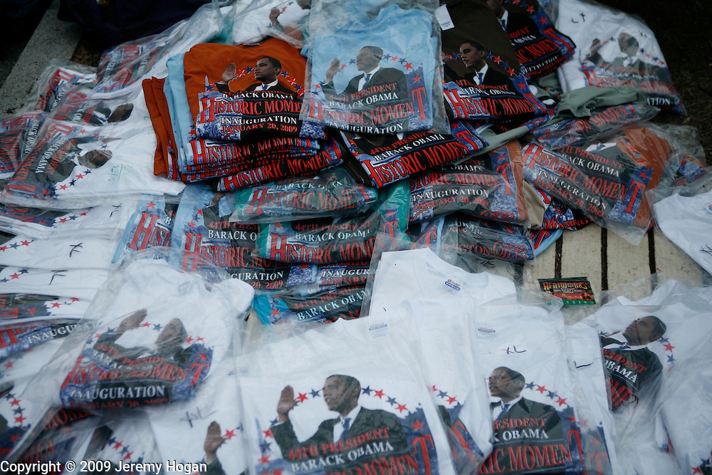 Vendors sell Barack Obama merchandise near the capitol building on the eve of the inauguration.