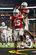 Ezekiel Elliott #15 of the Ohio State Buckeyes celebrates after scoring a 9 yard touchdown run against the Oregon Ducks in the 3rd quarter of the College Football Playoff National Championship Game at AT&T Stadium on January 12, 2015 in Arlington, Texas.  (Cooper Neill for The New York Times)