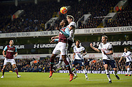 Eric Dier of Tottenham Hotspur heads the ball over Diafra Sakho of West Ham United. Barclays Premier league match, Tottenham Hotspur v West Ham Utd at White Hart Lane in London on Sunday 22nd November 2015.<br /> pic by John Patrick Fletcher, Andrew Orchard sports photography.