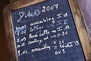 Chalk board on fermentation tanks with vinification notes chateau lestrille bordeaux france