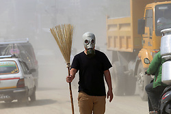 May 7, 2017 - Kathmandu, Nepal - A social activist wears a gas mask carries broom attend a performance art as a symbolic protest on air pollution at a dusty road in Kathmandu, Nepal. Kathmandu is being one of the most polluted city of world due to lot of problems of air pollution. (Credit Image: © Sunil Sharma via ZUMA Wire)
